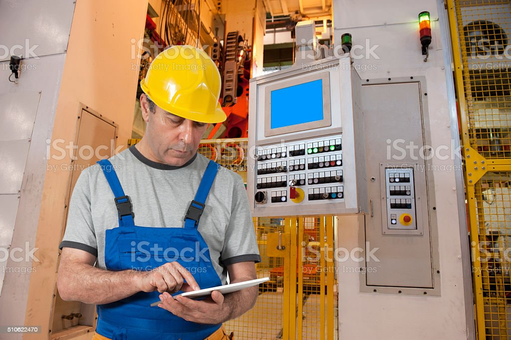 automotive factory worker using tablet stock photo