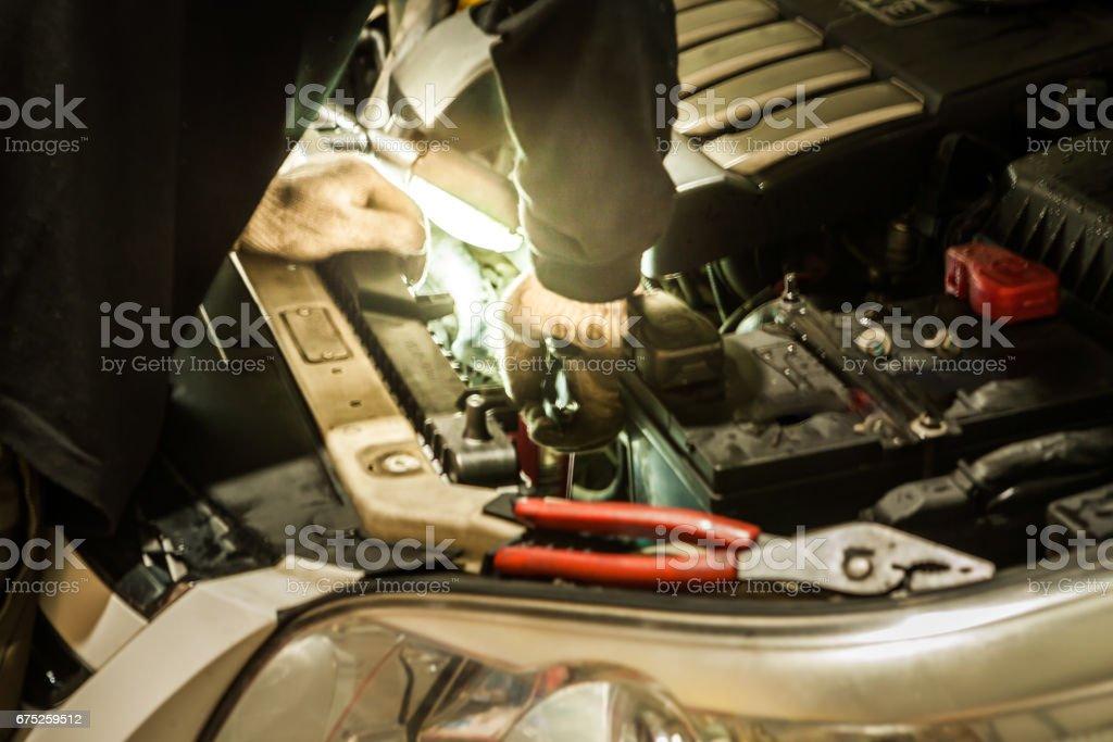 Automotive maintenance close-up under electric work lights/Car maintenance stock photo
