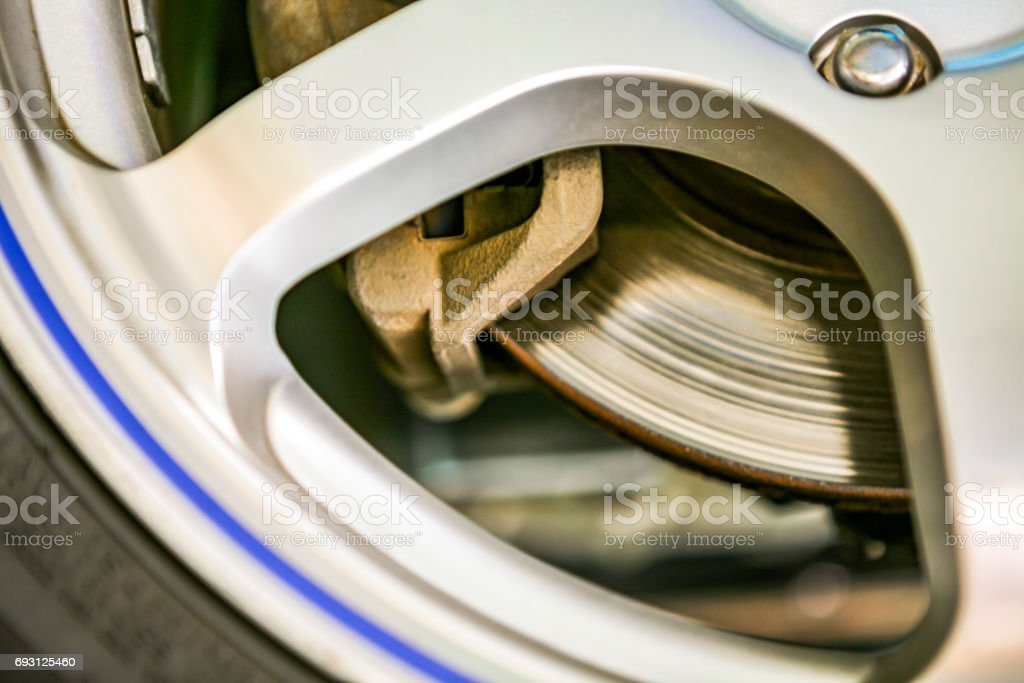 Automotive safety devices Tire wheels and brake pads, Automotive lining stock photo