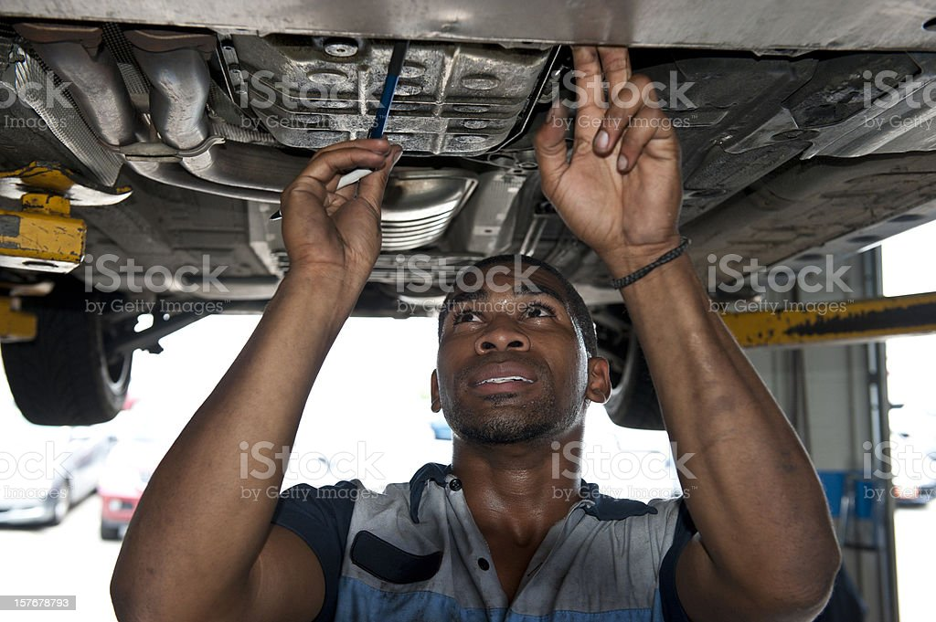 Automotive Technician Examining Vehicle royalty-free stock photo