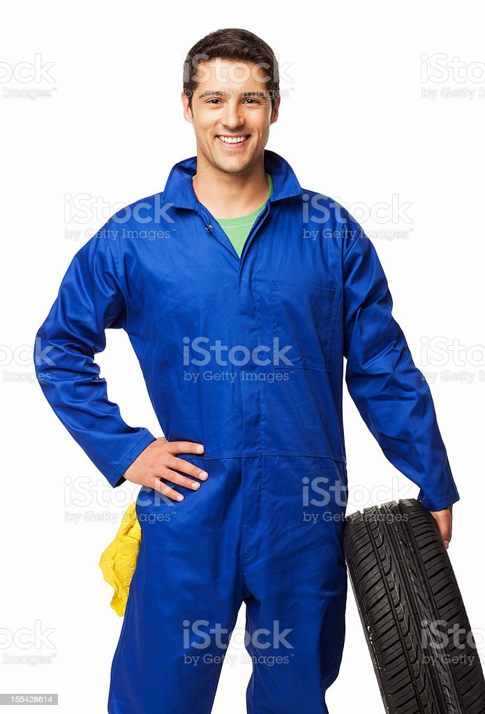 Automotive Technician Holding a Spare Tire - Isolated royalty-free stock photo