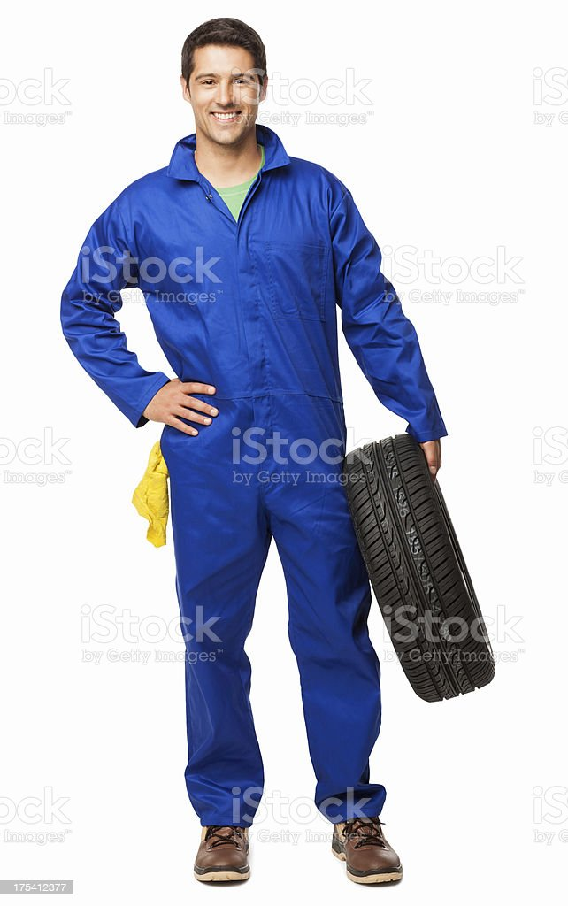 Automotive Technician Holding a Spare Tyre - Isolated stock photo
