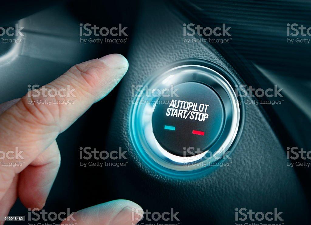 Autopilot button in the autonomous car stock photo