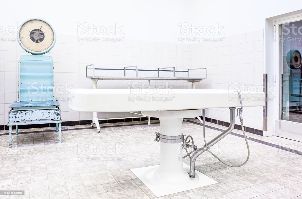 Autopsy tables in morgue stock photo
