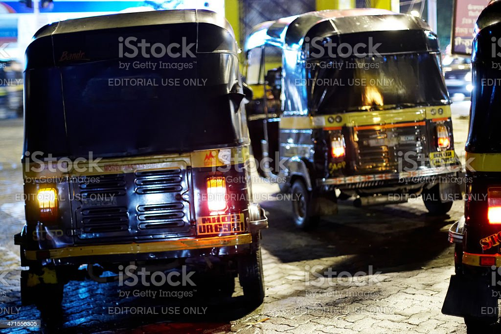 Autorickshaws at night in Mumbai royalty-free stock photo