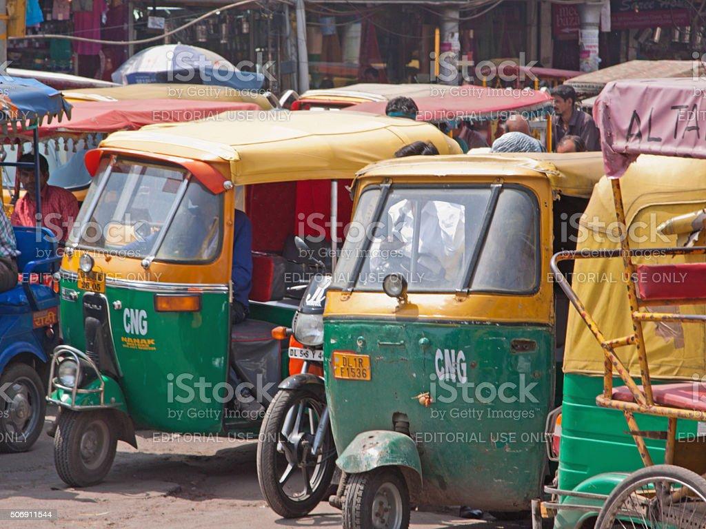 Autorickshaws in a Delhi parking area ready to take passengers stock photo