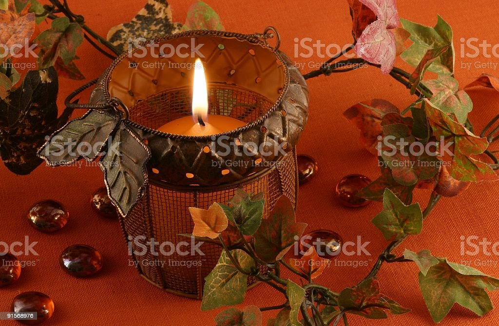 Autumn Acorn Candle with Fall Leaves royalty-free stock photo