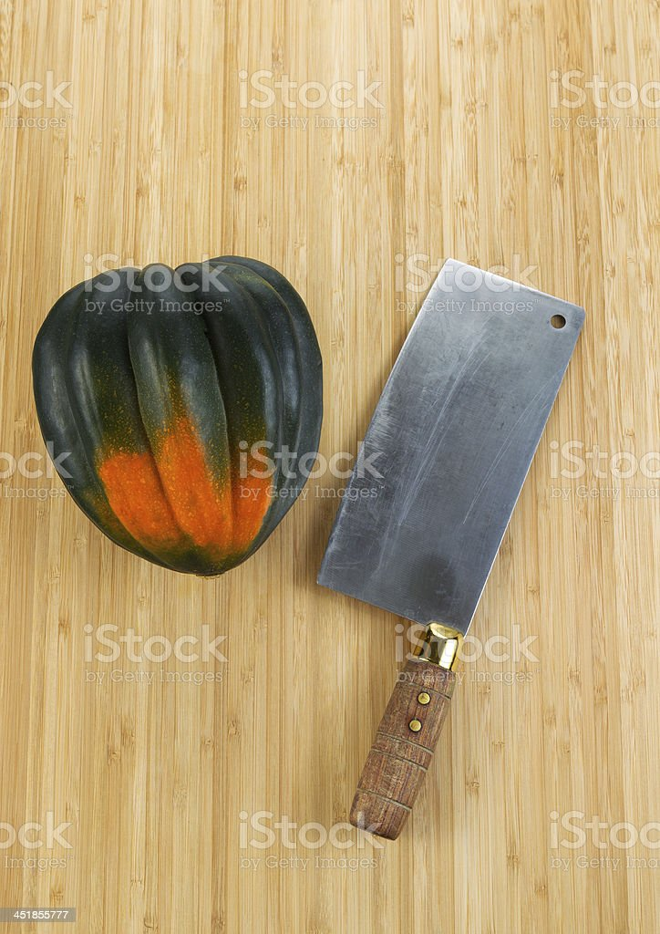 Autumn Acorn Squash with Butcher Knife on Cutting Board royalty-free stock photo