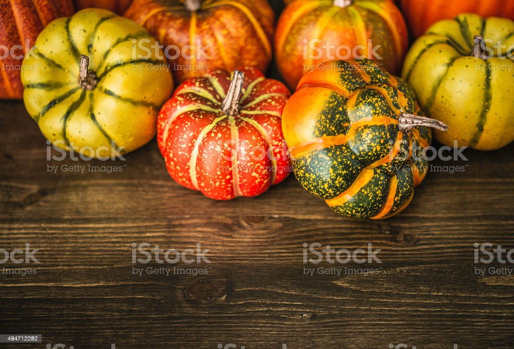 Autumn and Thanksgiving decoration. Pumpkins on dark wood table stock photo