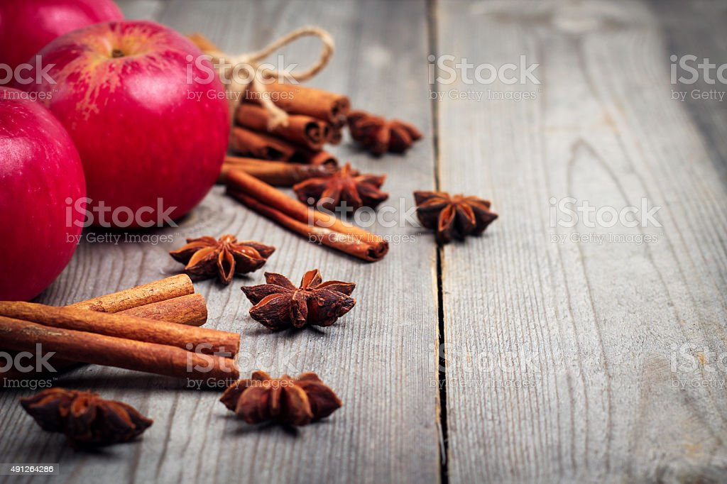 Autumn apples with spices, star anise and cinnamon sticks stock photo