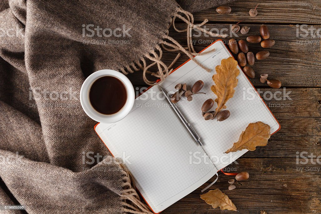 Autumn background, colorful leaves, acorn, cup of coffee and kni stock photo