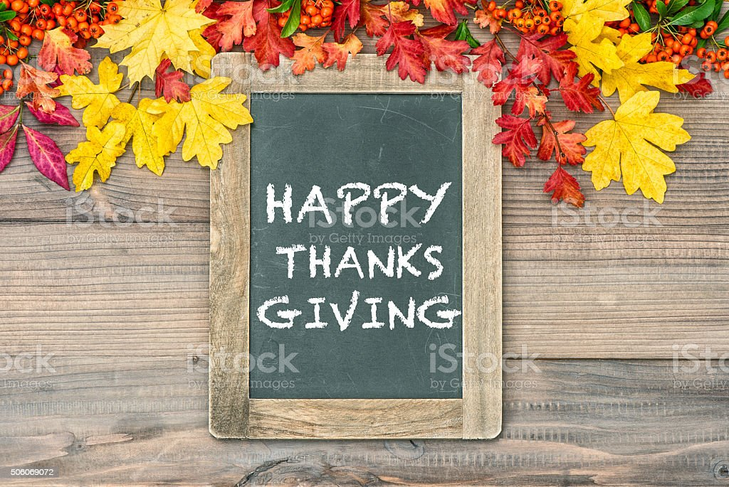 Autumn Background with cblackboard Happy Thanksgiving stock photo