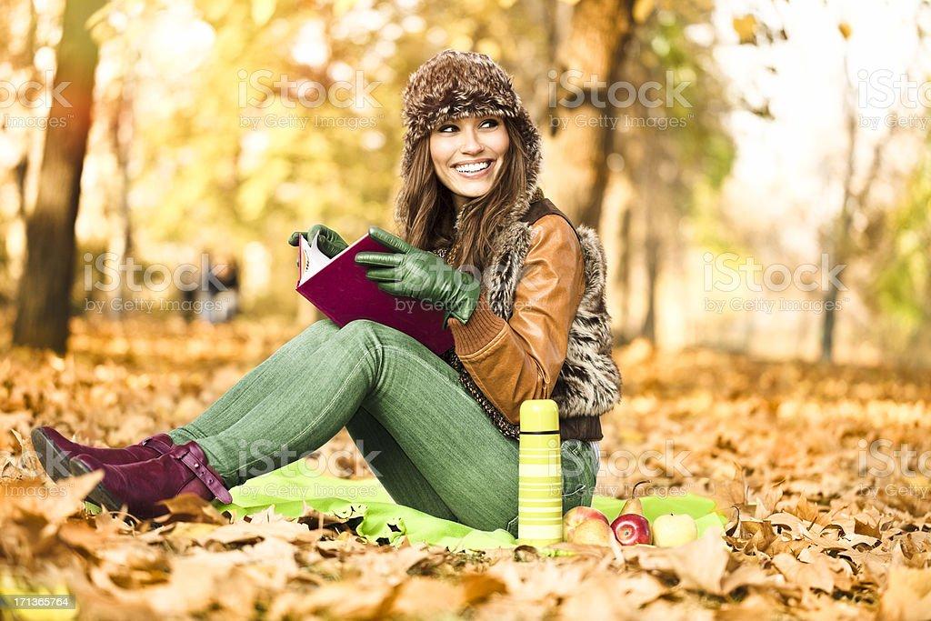 Autumn beauty reading outdoors royalty-free stock photo
