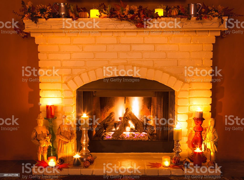 Autumn Brick fireplace decorated for Thanksgiving, candles, pilgrims, Sunflowers (P) stock photo