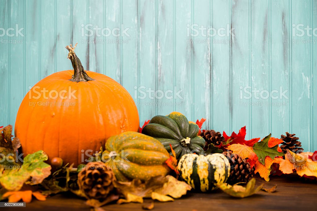 Autumn centerpiece with orange pumpkin, leaf decorations. stock photo
