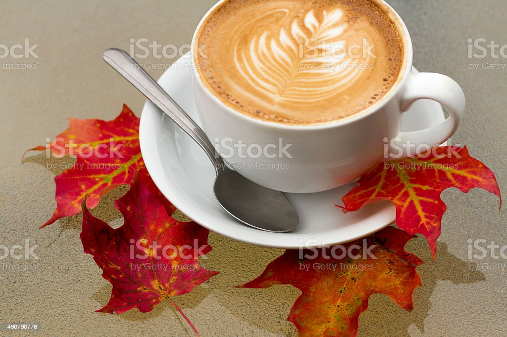 Autumn Coffee Latte with Orange and Red Fall Leaves stock photo