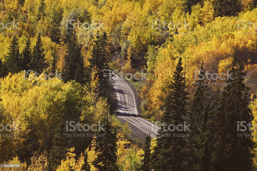 Autumn colored trees along mountain road in British Columbia stock photo