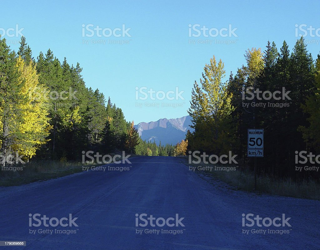 autumn colors along a mountain road royalty-free stock photo
