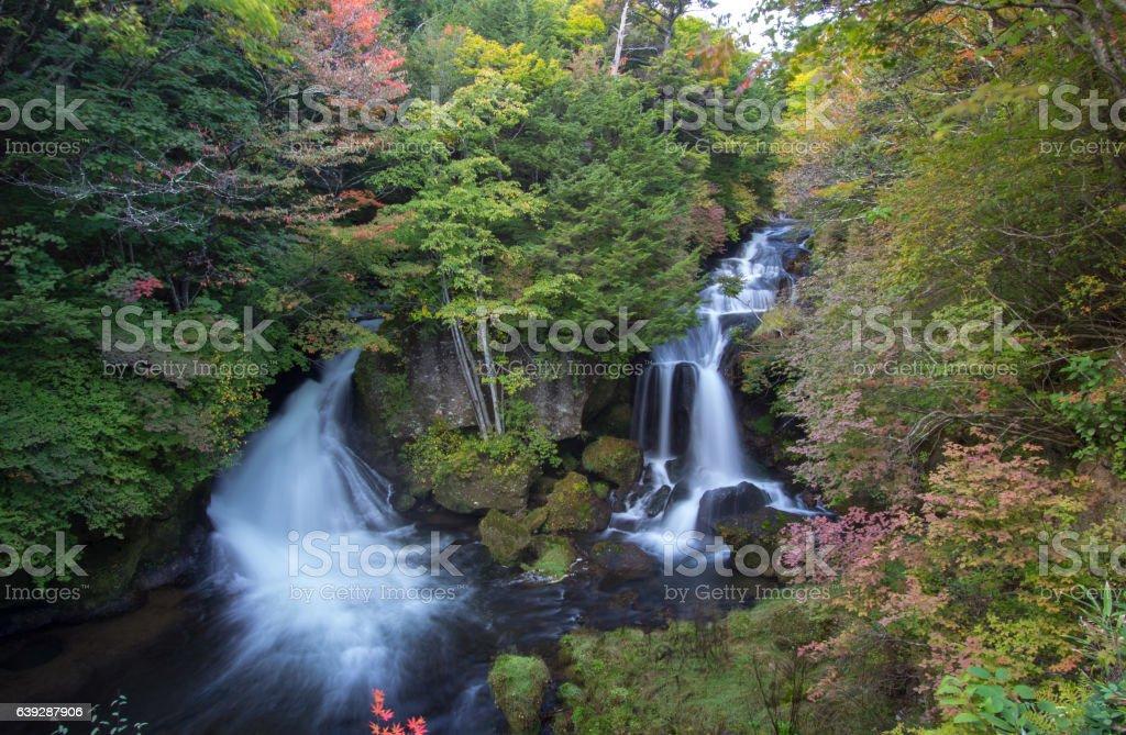 Autumn colors at Ryuzu Waterfall basin in Nikko, Japan stock photo