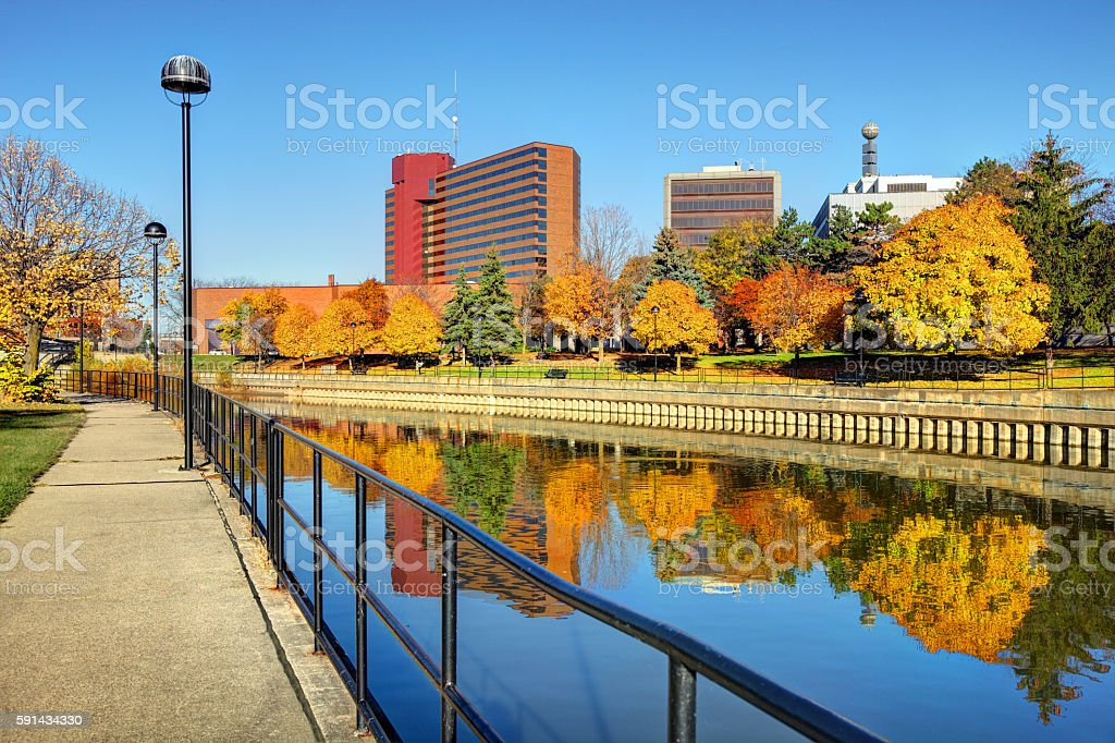 Autumn colors reflecting on the Flint River in Downtown Flint Michigan stock photo