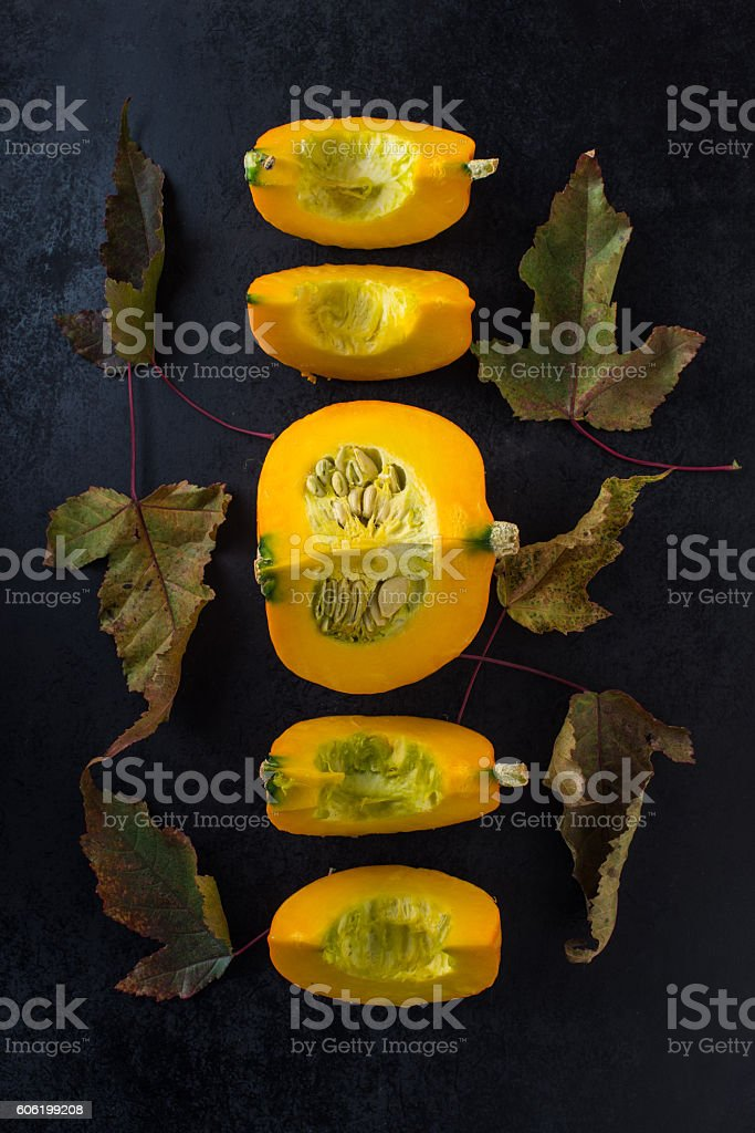 autumn composition with pumpkin and leaves stock photo