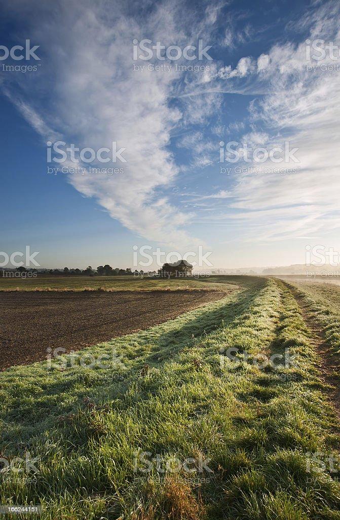 Autumn dawn landscape over frosty misty fields royalty-free stock photo