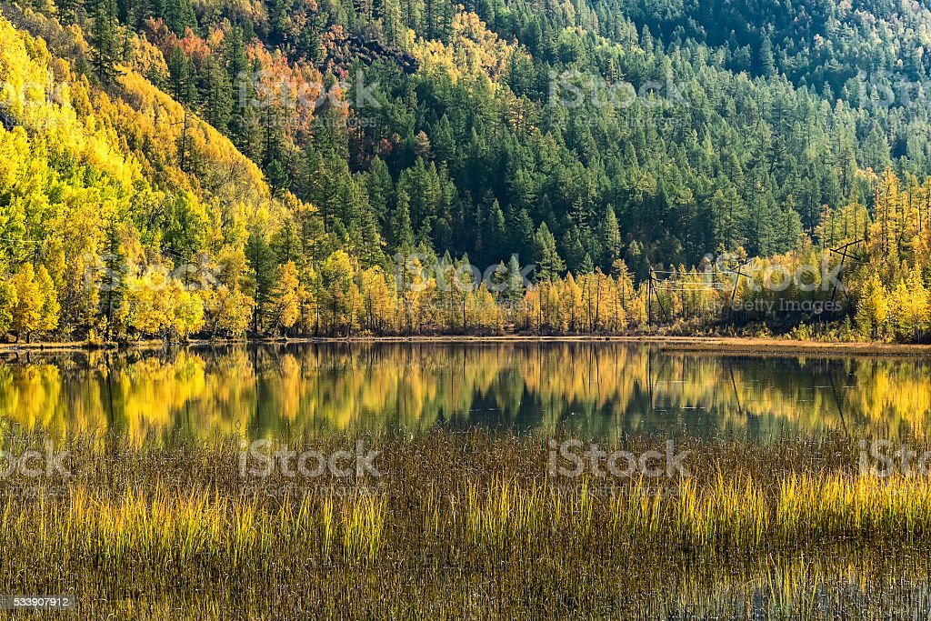 Autumn day at the lake in the mountains Sayan stock photo
