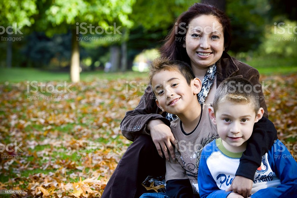 Autumn Day, Hispanic Family, Single Mom with Two Sons, Copyspace stock photo