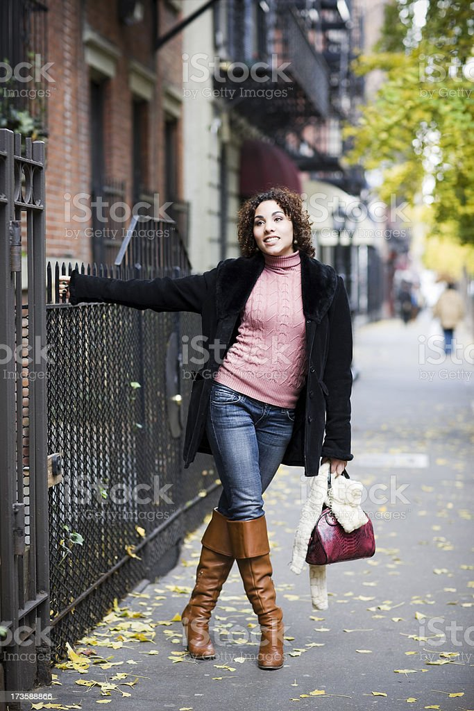 Autumn Day with Brunette Young Woman in New York City royalty-free stock photo