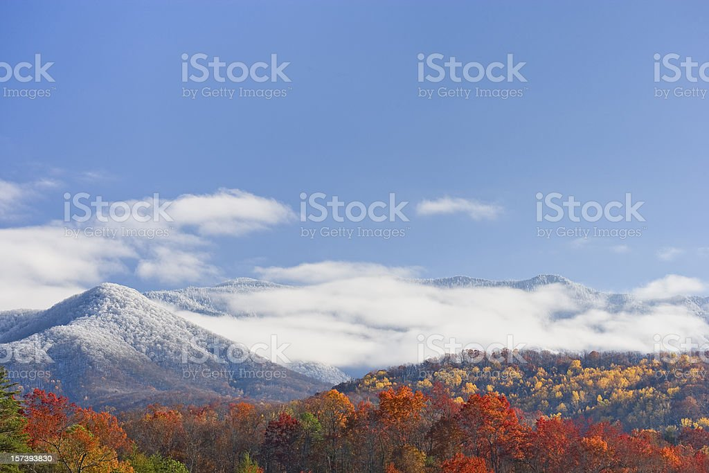 Autumn day with snowfall on the mountains stock photo