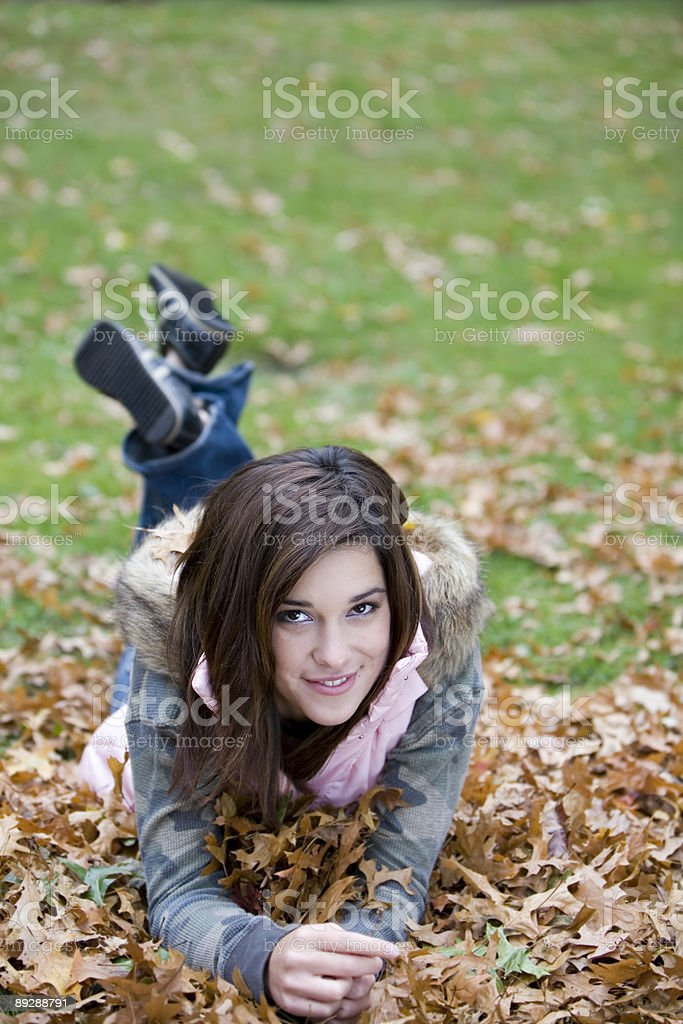 Autumn Day with Young Teenage Girl in Park, Copy Space royalty-free stock photo
