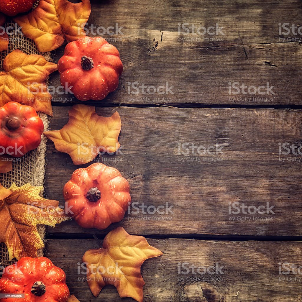 Autumn Decoration Background with Leafs and Pumpkins stock photo