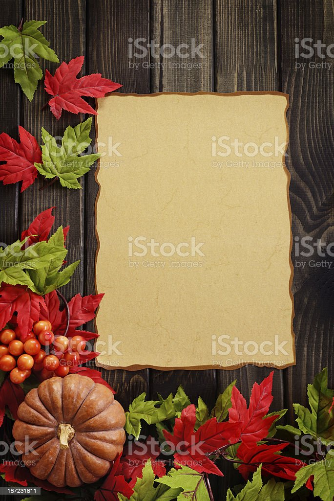 Autumn decoration with an empty ancient paper on woods royalty-free stock photo