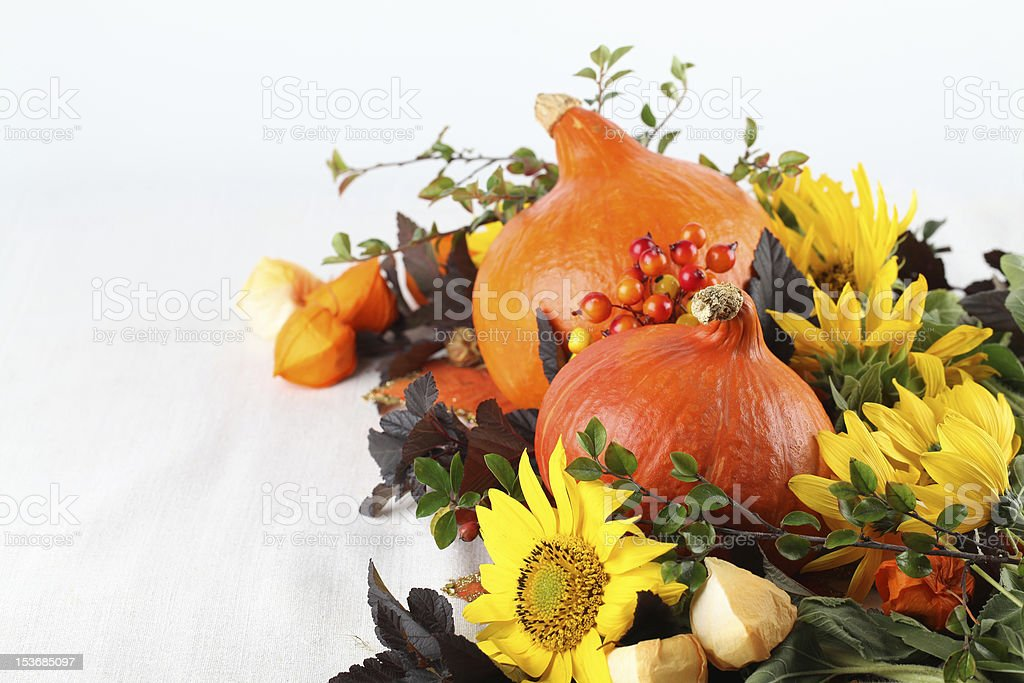 Autumn decoration with hokkaido pumpkins and sunflowers royalty-free stock photo