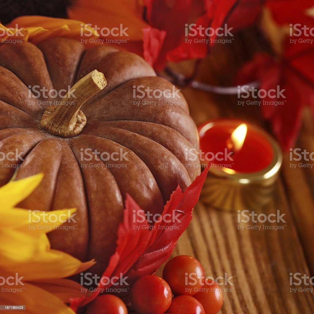 Autumn decoration with maple leaves and pumpkins royalty-free stock photo
