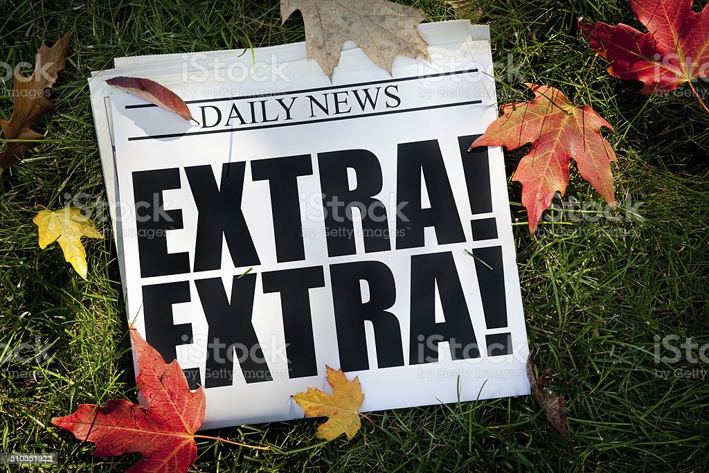 Autumn EXTRA! Newspaper on Grass with Fall Leaves stock photo