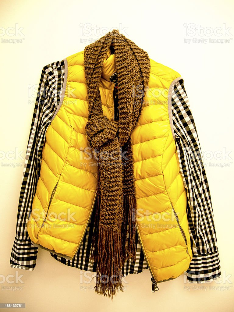 Autumn Fashion hanging in a yellow wall stock photo