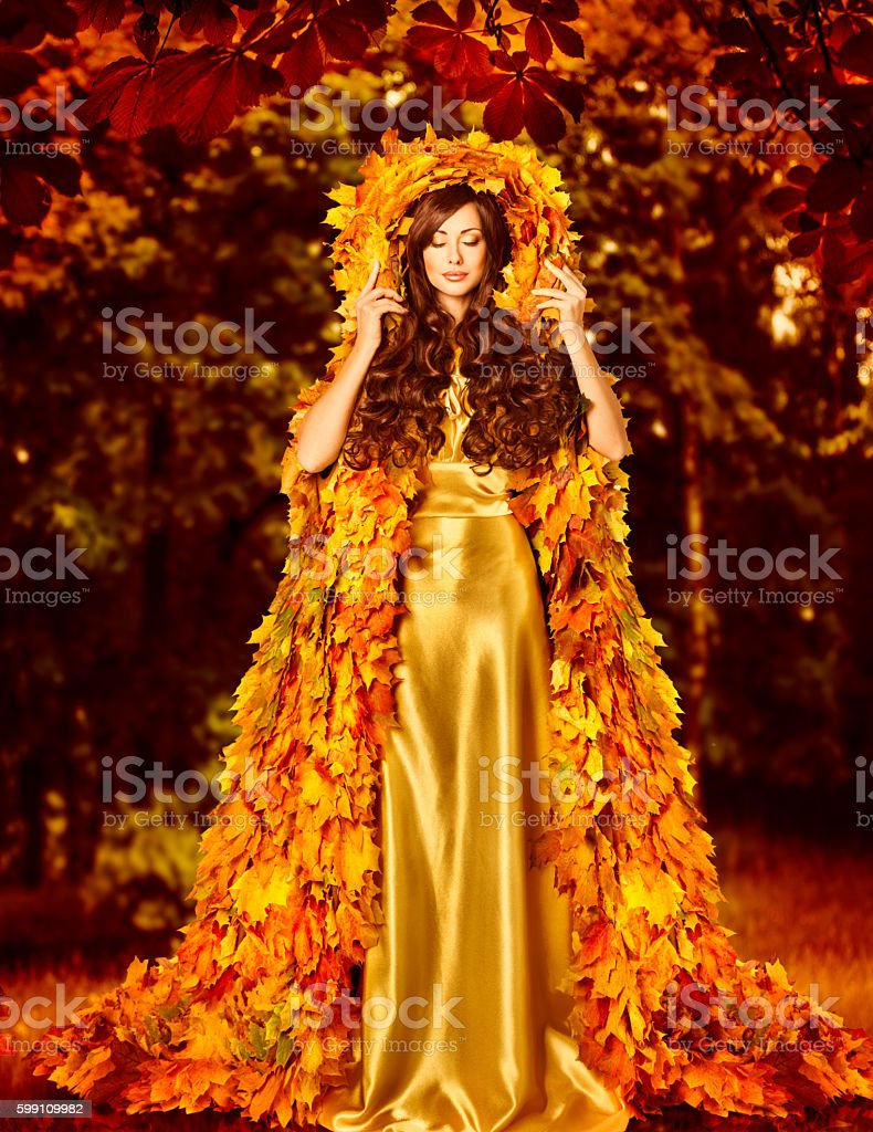 Autumn Fashion Woman Fall Leaves Dress, Girl Standing Outdoor stock photo