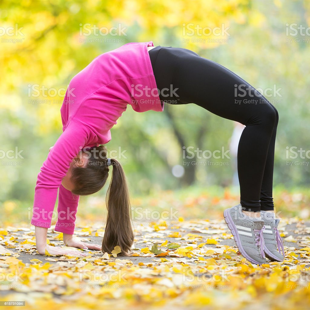 Autumn fitness: Bridge Pose stock photo
