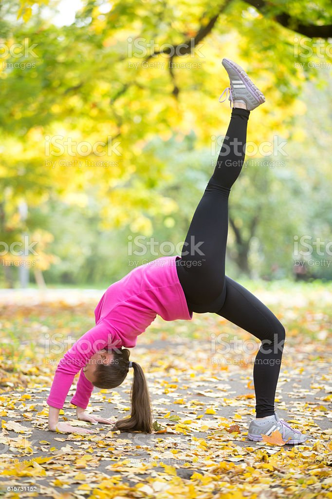 Autumn fitness: One-legged Bridge Pose stock photo