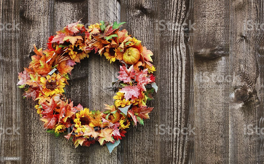 Autumn flower wreath against wooden background royalty-free stock photo