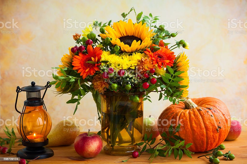Autumn flowers and pumpkin stock photo