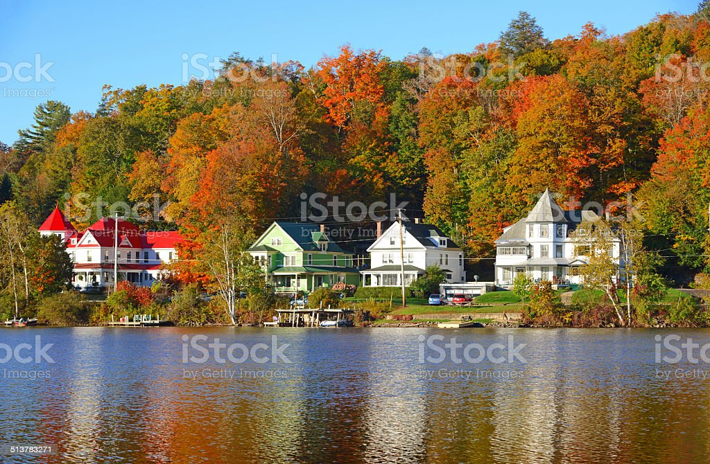 Autumn Foliage reflecting in Lake, Adirondacks, New York stock photo