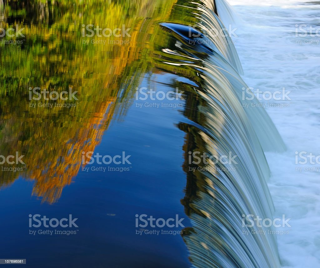 Autumn Forest reflecting in a Waterfall stock photo