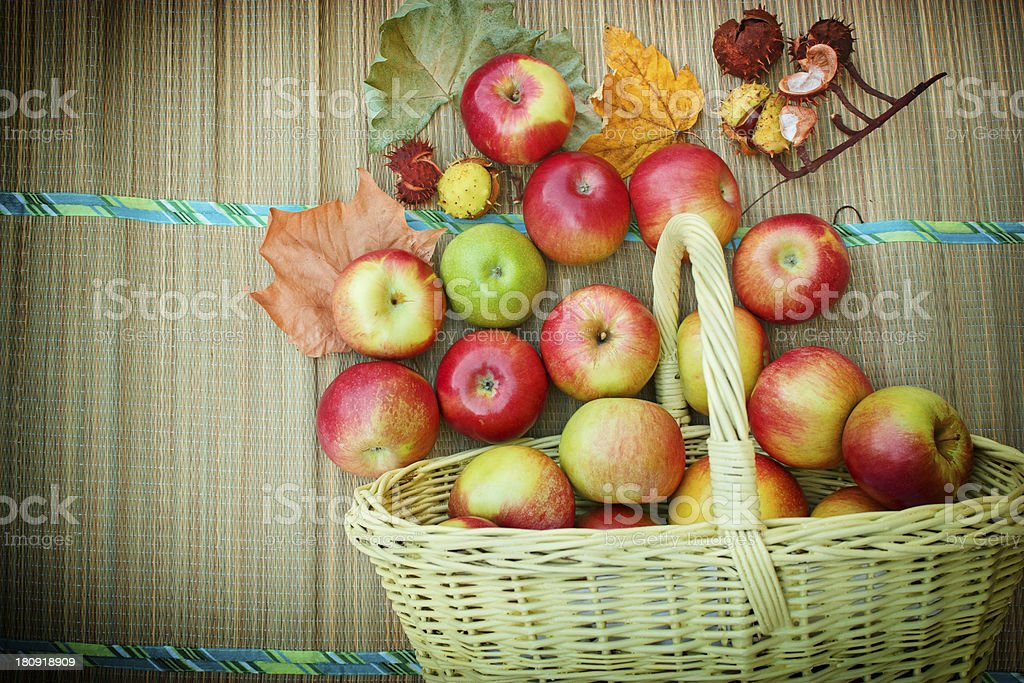 Autumn fruit in a wicker basket royalty-free stock photo