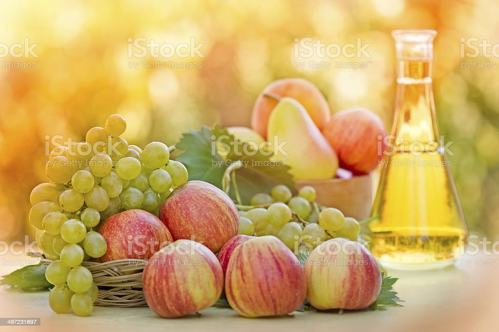 Autumn fruits and white wine royalty-free stock photo