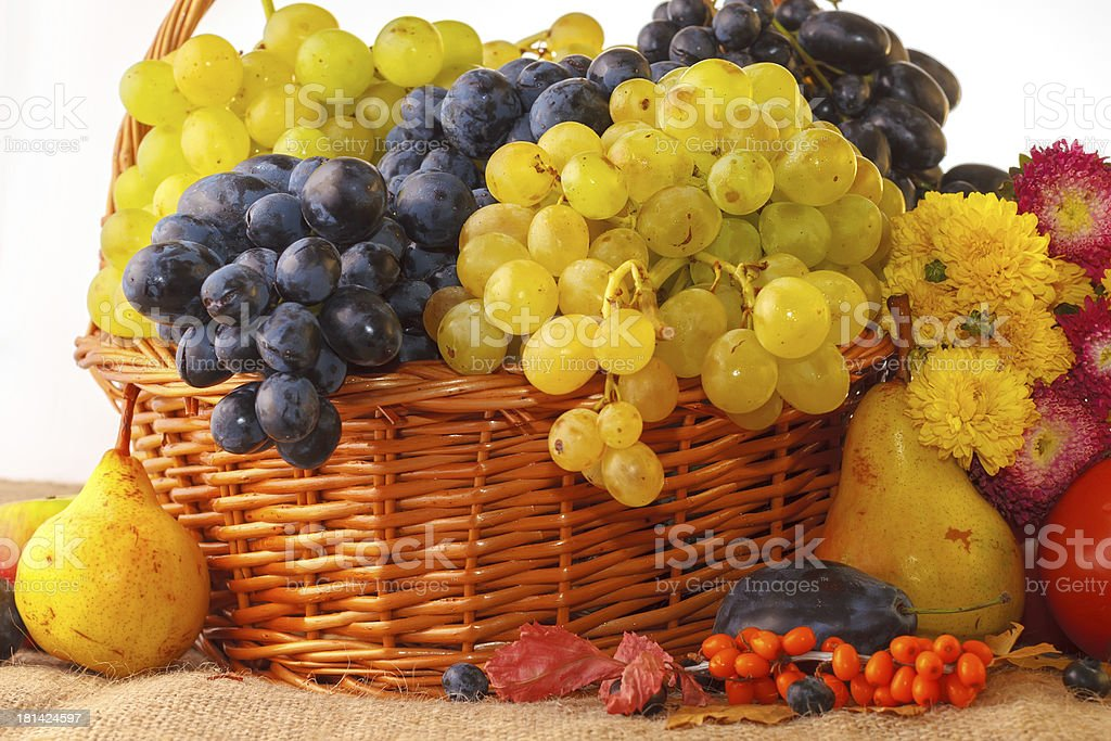 Autumn fruits in a basket royalty-free stock photo