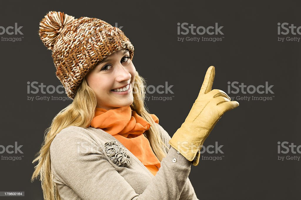 Autumn girl pointing up stock photo