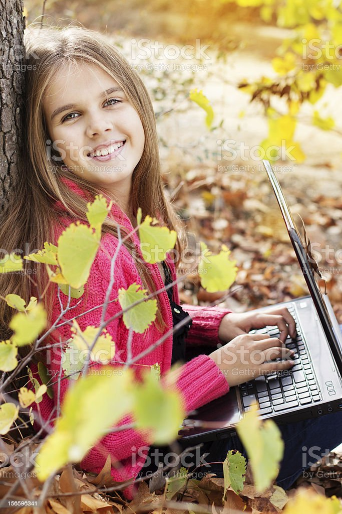 Autumn. girl  with laptop royalty-free stock photo