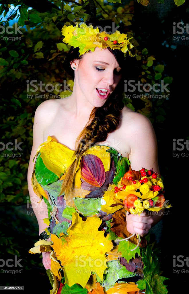 Autumn girl with leaves dress stock photo